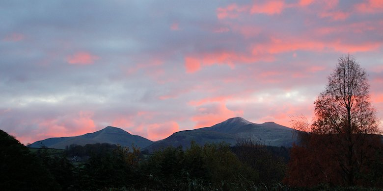 Clouds over the Brecon Beacons tinged with red from the setting sun: 23rd November 2013